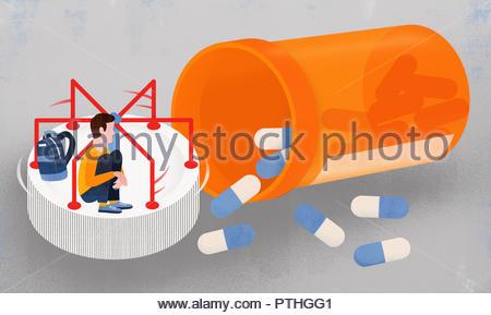 Boy on pill bottle roundabout - Stock Image