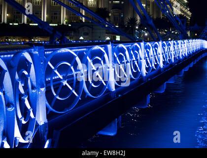 Cavanagh bridge at night in Singapore - Stock Image
