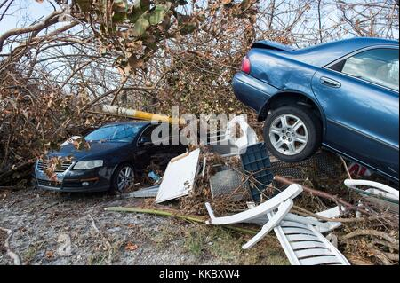 Debris and damaged cars behind the Big Pine Key Welcome Center in the aftermath of Hurricane Irma September 17, - Stock Image
