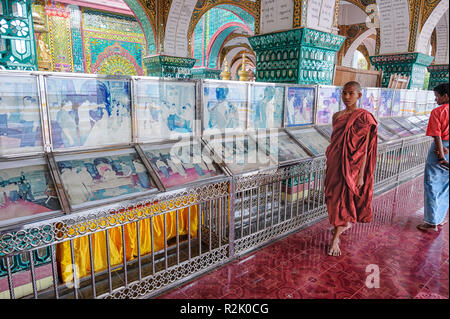 Photographs displayed at the  Su Taung Pyae Pagoda, Mandalay Hill, Mandalay Myanmar - Stock Image