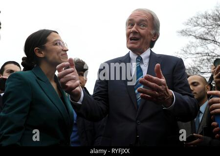 U.S. Senator Ed Markey and Rep. Alexandria Ocasio-Cortez, answers questions during the announcement for the Green New Deal legislation during a press conference outside the Capitol Building February 7, 2019 in Washington, D.C. - Stock Image