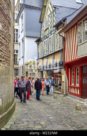 Tourists walking in the old streets of Rennes the capital of Brittany, France - Stock Image