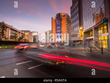 Traffic in the morning at European Commission building behind in Brusseles, Belgium - Stock Image