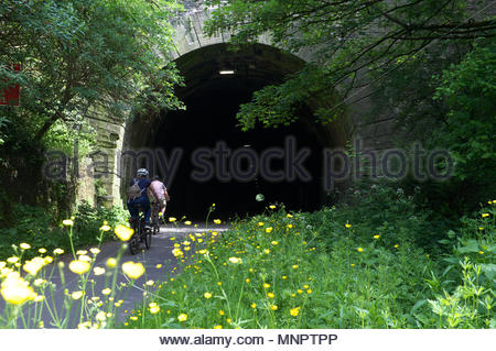 Bristol to Bath cycle path - two cyclists enter the 0.3-mile-long Staple Hill Tunnel in Bristol, UK. - Stock Image