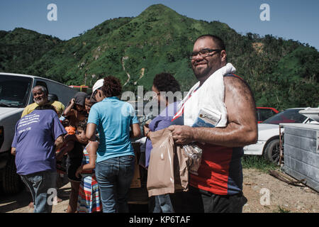 Loiza Methodist Church volunteers deliver emergency supplies to Puerto Rican residents during relief efforts following - Stock Image