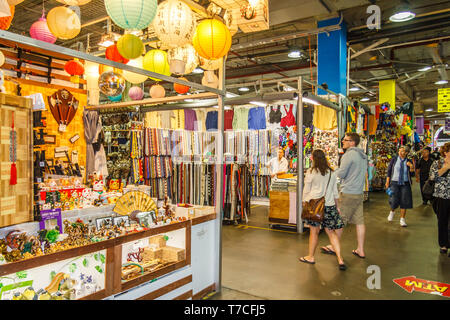 Sydney, Australia - 15th March 2013: Clothing and souvenir stalls in Paddy's market. The market is located in Haymarket. - Stock Image