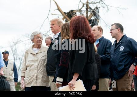 Opelika, Alabama, USA. 08th March, 2019. U.S President Donald Trump surveys damage and meets with residents along with Alabama Gov. Kay Ivey, left, and Senator Richard Shelby, right, March 8, 2019 in Opelika, Alabama. The region was hit by a tornado on March 3rd killing 23 people. Credit: Planetpix/Alamy Live News - Stock Image