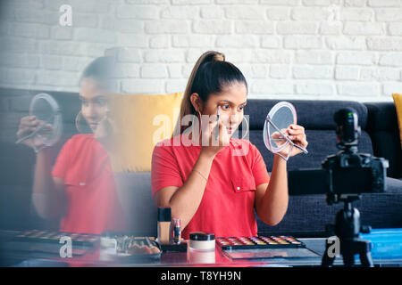 Girl Recording Vlog Video Blog At Home With Digital Camera - Stock Image