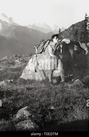 1950s, adult male camper having a morning shave on the mountain side. - Stock Image