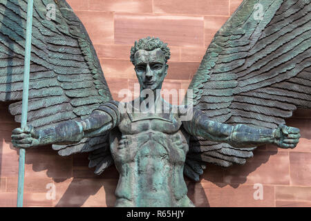 Coventry, UK - July 26th 2018: A close-up of the sculpture on the exterior of Coventry Cathedral depicting St. Michaels victory over the Devil, in Cov - Stock Image