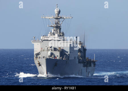 The U.S. Navy amphibious dock landing ship USS Ashland transits the Pacific Ocean prior to a training exercise March 8, 2019 in San Diego, California. - Stock Image