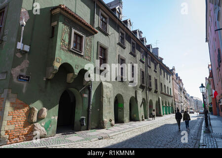 Wielkopolska Poland, view of a row 17th century buildings incorporating a  colonnade at ground level in Wodna Street in Poznan Old Town, Poland. - Stock Image
