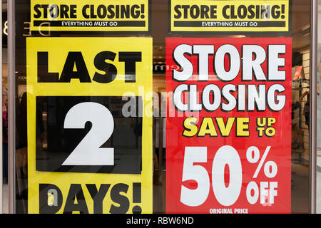 store closing! up to 50% sale off sign in a clothing store in the UK - Stock Image