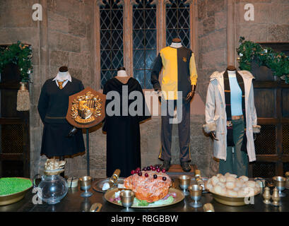Hufflepuff School Crest and Uniforms on display in  in the Great Hall, on the Making of Harry Potter Tour, Warner Brothers Studio's - Stock Image