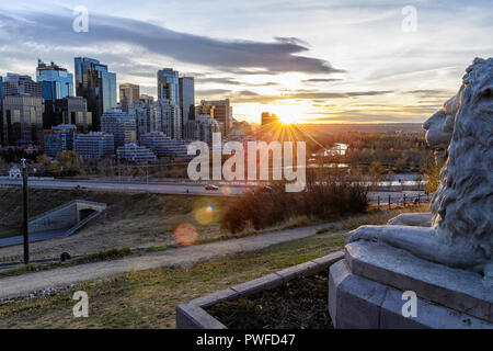 An iconic Calgary lion sculpture now overlooks its old home on Centre Street Bridge installed in Rotary Park - Stock Image