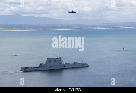 The Guided-missile destroyer USS Zumwalt departs Naval Base San Diego on the first deployment of the newest ship design in the fleet March 8, 2019 in San Diego, California. - Stock Image
