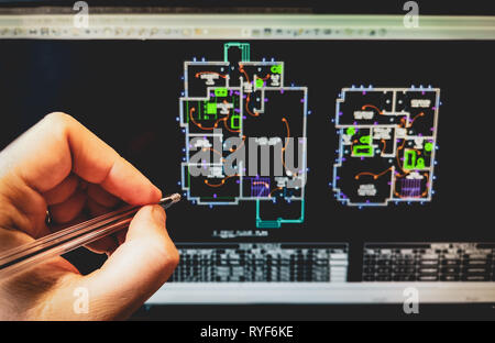 cad software drawing on the computer screen with hand holding pen - Stock Image
