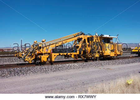 Union Pacific HARSCO 6700SJ2 PD Production / Switch Tamper parked on siding in southwestern New Mexico, USA - Stock Image