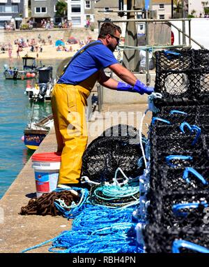 Local fisherman getting brand new lobster pots ready to go to sea,St Ives,Cornwall,England,UK - Stock Image