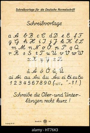 A sample of a written German font. School program. East Germany (GDR), circa 1970 - Stock Image