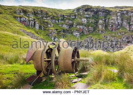 Disused Coity Mawr Quarry, Blaenavon World Heritage site, Torfaen, Gwent, Wales, UK, with brake drum at the top of inclined tramroad. - Stock Image
