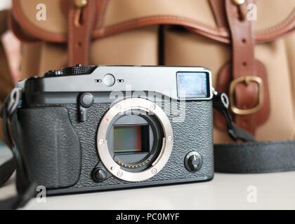 Fuji Mirrorless system camera with sensor visible, with billingham camera bag - Stock Image