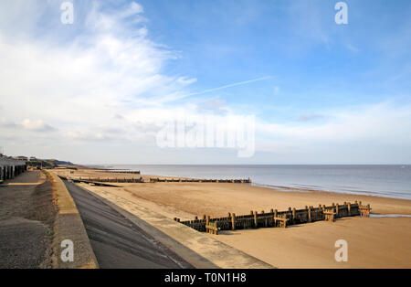 A view of the beach looking westwards towards Mundesley on the North Norfolk coast at Bacton-on-Sea, Norfolk, England, United Kingdom, Europe. - Stock Image