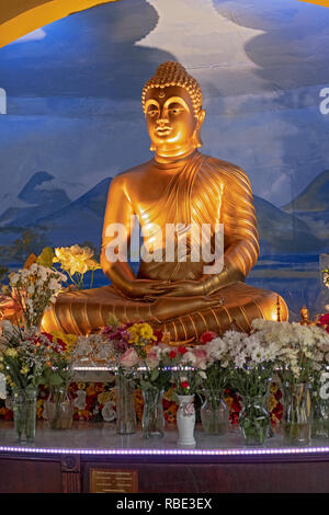 A statue of the Buddha in the Shrine Room at the New York Buddhist Vihara Association in Queens Village, Queens, New York City. - Stock Image