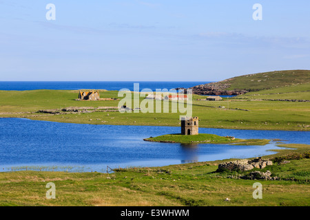 View to Loch Scolpaig with Georgian folly Tower on small islet on west coast North Uist Outer Hebrides Western Isles - Stock Image