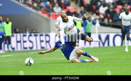 Lucas Moura of Spurs is fouled by Joe Ralls of Cardiff who was then sent off for the challenge in the second half during the Premier League match between Tottenham Hotspur and Cardiff City at Wembley Stadium , London , 06 October 2018 - Stock Image