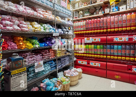 A corner of the iconic ECONOMY CANDY store on the lower east side with chocolates, jelly beans and a vintage token machine. New York City. - Stock Image