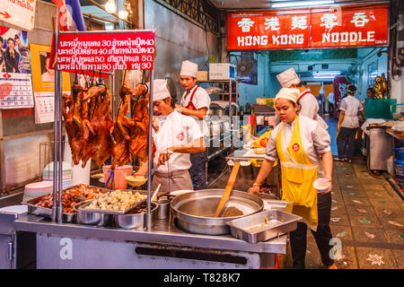 Bangkok, Thailand - April 21st 2011. Kitchen staff in the Hong Noodle restaurant. The establishment is located in Chinatown. - Stock Image