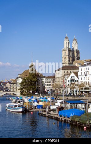 Zurich downdown in broad daylight with churches, river and boats portrait - Stock Image