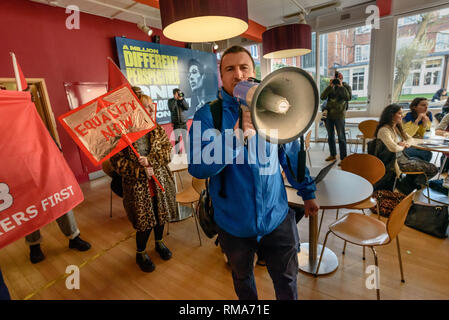 London, UK. 14th February 2019. The General Secretary of the IWGB, Jason Moyer-Lee speaks in a cafeteria inside the Richard Hoggart Building as they launch their campaign for Goldmsiths, University of London, to directly employ its security officers. Currently they are employed by CIS Security Ltd on low pay and minimal conditions of service, and CIS routinely flouts its legal responsibilities on statutory sick pay and holidays. Credit: Peter Marshall/Alamy Live News - Stock Image