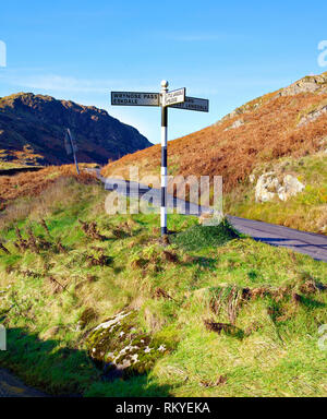 A view of a road sign in the hilly landscape of the English Lake District. - Stock Image