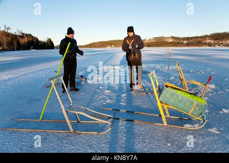 Brothers kicksledding Northern Sweden. - Stock Image