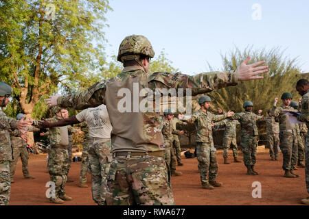 US Army airborne soldiers practise safety drills before conducting a parachute jump in Burkina Faso as part of the Flintlock 2019 training exercise. - Stock Image