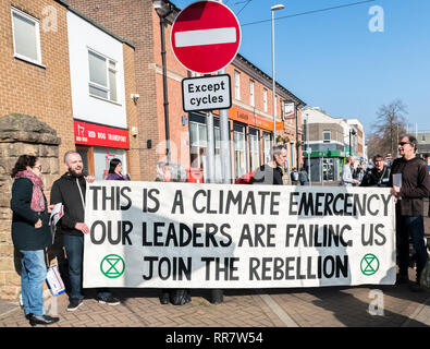 Climate change protesters with a large banner. - Stock Image