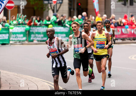 Jack Rayner (Australia),  leading Jonathon Mellor (Great Britain),  during the 2019 London Marathon. They wen on to finish 14th and  19th  respectively. - Stock Image