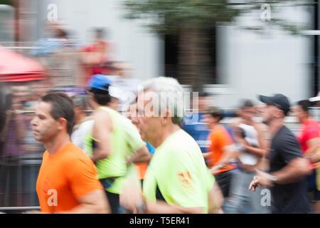 Blur motion, abstract background, long exposure shoot of competitors at Corrida Internacional (International Race) de Sao Silvestre, Sao Paulo, Brazil - Stock Image