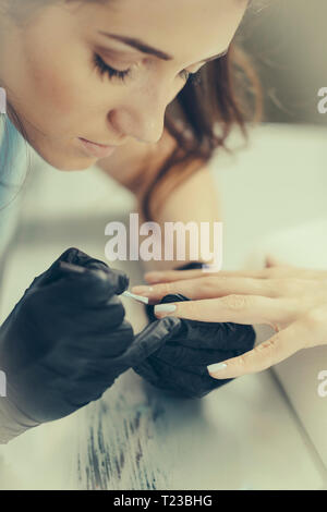Woman having manicure. - Stock Image
