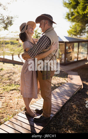 Senior couple hugging each other - Stock Image