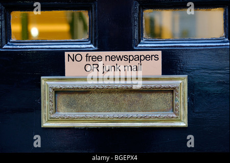 Front door residential letterbox 'No free newspapers or junk mail'. London. UK 2009 - Stock Image