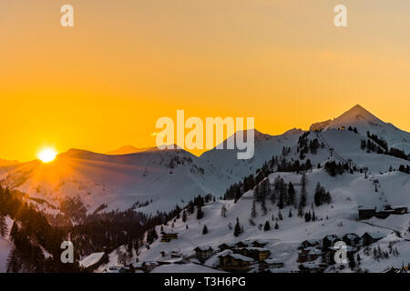 Setting sun over the mountains in Obertauern, Austria - Stock Image
