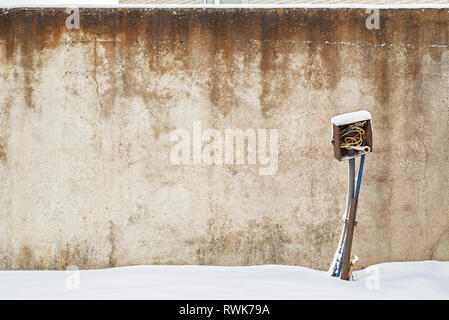abandoned grunge house with electrical equipment near the wall in winter - Stock Image
