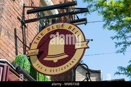 An exterior mounted pub sign for the pub and restaurant The Blue Bell in Warrington Cheshire May 2018 - Stock Image