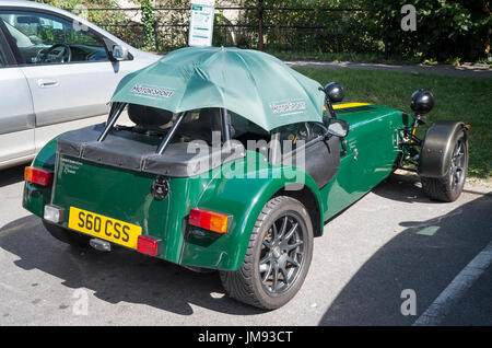 Caterham Superlight R300 English two-seater sports car with sunshade in a public car park in UK - Stock Image