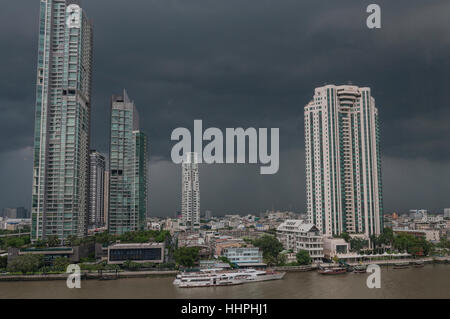 A picture of downtown Bangkok, Thailand just before a storm, taken from the Shangri-La Hotel across the Chao Phraya - Stock Image