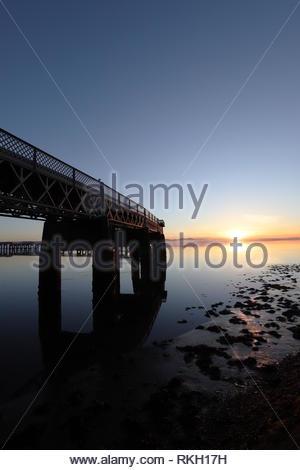 Tay Rail Bridge reflected in River Tay at dusk Dundee Scotland  January 2019 - Stock Image