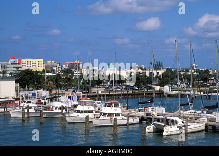 Miami Florida FL South Beach marina with boats at dock skyline behind - Stock Image